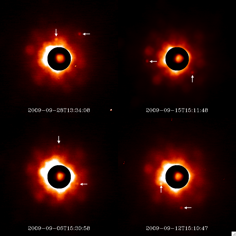 Images of the asteroid Minerva and its two moons (highlighted by the arrows) made using the Keck Observatory in Hawaii. Credit: F Marchis, SETI Institute.