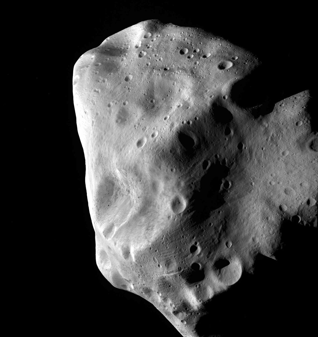This image of the unusual asteroid Lutetia was taken by ESA's Rosetta probe during its closest approach in July 2010. Lutetia, which is about 100 kilometres across, seems to be a leftover fragment of the same original material that formed the Earth, Venus and Mercury. It is now part of the main asteroid belt, between the orbits of Mars and Jupiter, but its composition suggests that it was originally much closer to the Sun. Credit: ESA 2010 MPS for OSIRIS Team MPS/UPD/LAM/IAA/RSSD/INTA/UPM/DASP/IDA